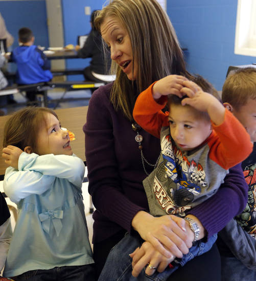 Kary Trent holds Zane Whitmire as she talks with Emily Bear in the cafeteria at Ryal Public School, Wednesday, Feb. 13, 2013. Photo by Sarah Phipps, The Oklahoman