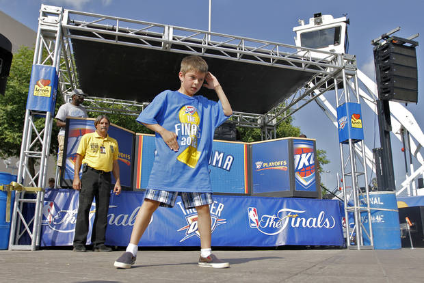 Gaza Booher, 9, dances in Thunder Alley during Game 2 of the NBA Finals between the Oklahoma City Thunder and the Miami Heat at Chesapeake Energy Arena in Oklahoma City, Thursday, June 14, 2012. Photo by Chris Landsberger, The Oklahoman