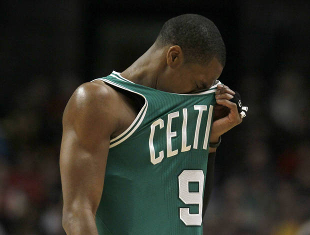 Boston Celtics point guard Rajon Rondo reacts during the second half of an NBA basketball game against the Chicago Bulls, Thursday, Feb. 16, 2012, in Chicago. The Bulls won 89-80. (AP Photo/Charles Rex Arbogast) ORG XMIT: CXA110