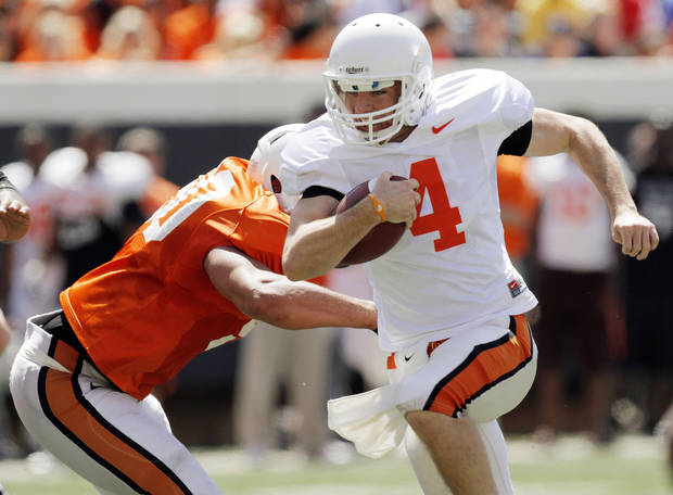 OSU's J.W. Walsh (4) breaks away from Jamie Blatnick (50) on a keeper during the Orange/White spring football game for the Oklahoma State University Cowboys at Boone Pickens Stadium in Stillwater, Okla., Saturday, April 16, 2011. Photo by Nate Billings, The Oklahoman