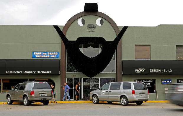 People on Thursday exit a building at 4416 N Western in Oklahoma City that is decorated to look like James Harden of the Oklahoma City Thunder. The city is gearing up for the NBA Finals, which will start Tuesday at Chesapeake Energy Arena. Photo by Bryan Terry, The Oklahoman