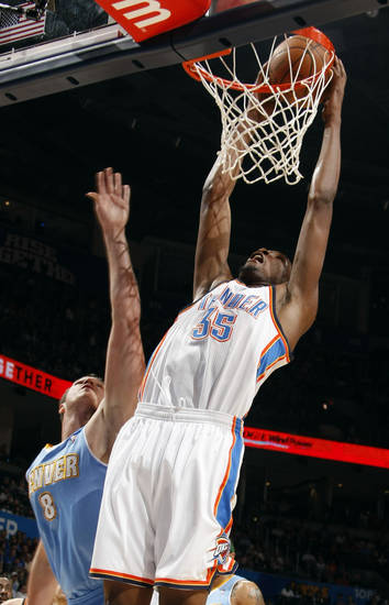 Oklahoma City's Kevin Durant (35) dunks in front of Denver's Danilo Gallinari (8) during the NBA basketball game between the Oklahoma City Thunder and the Denver Nuggets, Friday, April 8, 2011, at the Oklahoma City Arena.. Photo by Sarah Phipps, The Oklahoman