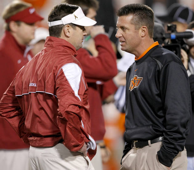 Oklahoma coach Bob Stoops, left, and Oklahoma State coach Mike Gundy talk before the Bedlam college football game between the University of Oklahoma Sooners (OU) and the Oklahoma State University Cowboys (OSU) at Boone Pickens Stadium in Stillwater, Okla., Saturday, Nov. 27, 2010. Photo by Bryan Terry, The Oklahoman