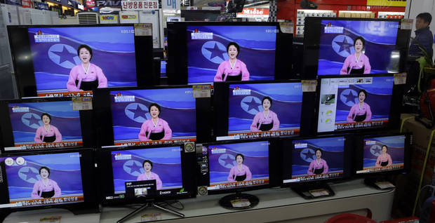A man watches TV screen showing a North Korean TV anchorwoman announcing the success of a rocket launch, at an electronic shop in Seoul, South Korea, Wednesday, Dec. 12, 2012. North Korea successfully fired a long-range rocket on Wednesday, defying international warnings as the regime of Kim Jong Un took a giant step forward in its quest to develop the technology to deliver a nuclear warhead. (AP Photo/Lee Jin-man) ORG XMIT: LJM103