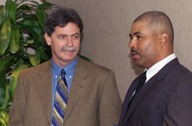 Current Brewers general manager Doug Melvin, left, was the Texas Rangers&#039; general manager from 1994-2001. Here he talks with former RedHawks manager DeMarlo Hale. Photo by The Oklahoman Archive