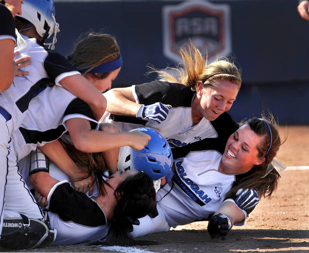 Oologah players mob each other after the winning run is scored. Class 4A high school championship softball game between Oologah and Piedmont at Hall of Fame Stadium in Oklahoma City on Saturday, Oct. 15, 2012.  Oologah won the game in the bottom of the sixth inning when Baleigh Hamilton scored the winning run on a hit by Alex Edinger, allowing them to claim the victory by virtue of the the run rule, defeating Piedmont,  10-0.    Photo by Jim Beckel, The Oklahoman