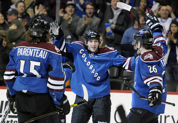 Colorado Avalanche center Matt Duchene, center, celebrates a goal with teammates P.A. Parenteau, left, and Paul Stastny, right, in the first period of an NHL hockey game against the San Jose Sharks on Sunday, March 10, 2013, in Denver.  (AP Photo/Chris Schneider)