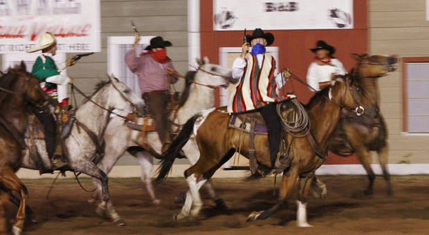 Outlaws ride into the arena during an act at the Pawnee Bill Wild West Show in Pawnee, Oklahoma on Saturday,  June 23, 2012.  Photo by Jim Beckel, The Oklahoman