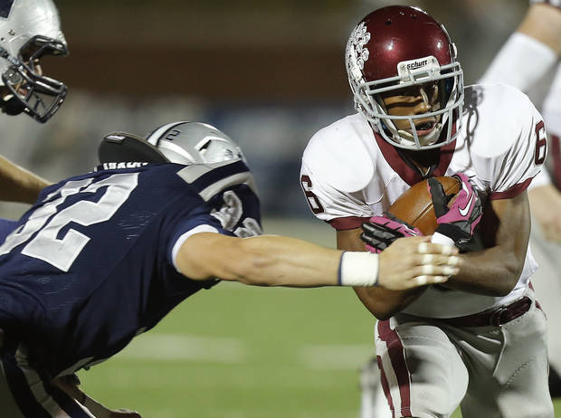Edmond Memorial's Warren Wand runs past  Edmond North's Lance Dixon for a touchdown during a high school football playoff game at Wantland Stadium in Edmond, Okla., Thursday, Nov. 8, 2012. Photo by Bryan Terry, The Oklahoman