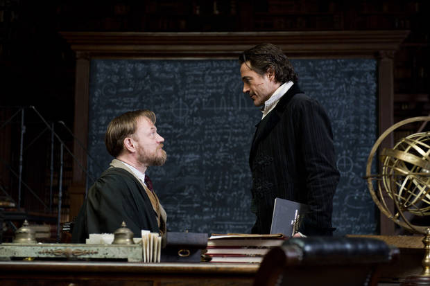 "In this image released by Warner Bros. Pictures, Jared Harris portraying Professor James Moriarty, left, and Robert Downey Jr., portraying Sherlock Holmes, are shown in a scene from ""Sherlock Holmes: A Game of Shadows."" Moriarty, who has loomed as the grandfather of all super-villains, is played with cool, quiet, chilling detachment by Jared Harris. (AP Photo/Warner Bros. Pictures, Daniel Smith) ORG XMIT: NYET149"