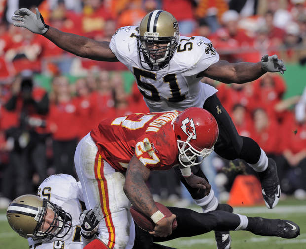 FILE - This Nov. 16, 2008 file photo shows New Orleans Saints linebacker Jonathan Vilma (51) flying in to help stop Kansas City Chiefs running back Larry Johnson (27) as he's tied up by New Orleans Saints linebacker Scott Fujita, lower left, late in the second quarter of an NFL football game in Kansas City, Mo. Vilma has been suspended without pay for the entire 2012 season by the NFL, one of four players punished for participating in a pay-for-pain bounty system. NFL Commissioner Roger Goodell's ruling was announced Wednesday, May 2, 2012 . (AP Photo/Reed Hoffmann, File)