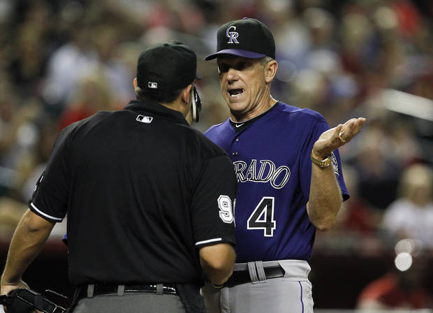Colorado Rockies manager Jim Tracy (4) argues with umpire Mark Ripperger after thinking that Andrew Brown was hit by a pitch during the eighth inning of a baseball game against the Arizona Diamondbacks, Wednesday, Oct. 3, 2012, in Phoenix. The Rockies defeated the Diamondbacks 2-1. (AP Photo/Ross D. Franklin)