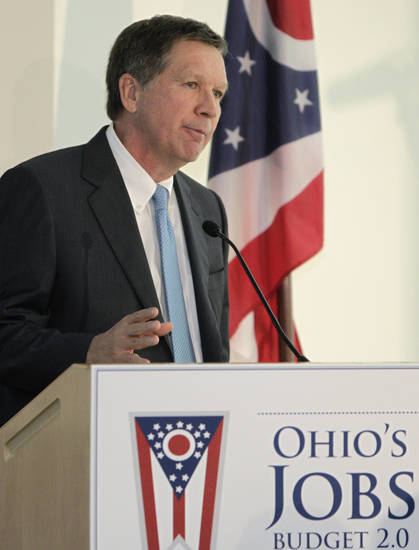 Ohio Gov. John Kasich presents the fiscal year 2014-15 executive budget proposal during a news conference Monday, Feb. 4, 2013, in Columbus, Ohio. (AP Photo/Jay LaPrete)