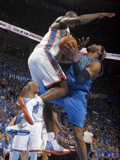 Oklahoma City's Serge Ibaka (9) fouls Dallas' Vince Carter (25) during game one of the first round in the NBA playoffs between the Oklahoma City Thunder and the Dallas Mavericks at Chesapeake Energy Arena in Oklahoma City, Saturday, April 28, 2012. Photo by Sarah Phipps, The Oklahoman