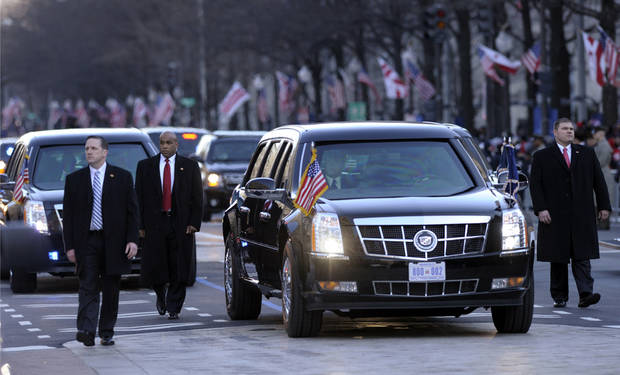 The presidential limousine with President Barack Obama and first lady Michelle Obama inside, heads down Pennsylvania Avenue in the Inaugural Parade after the ceremonial swearing-in for the 57th Presidential Inauguration on Capitol Hill in Washington, Monday, Jan. 21, 2013. (AP Photo/Susan Walsh) ORG XMIT: DCSW103