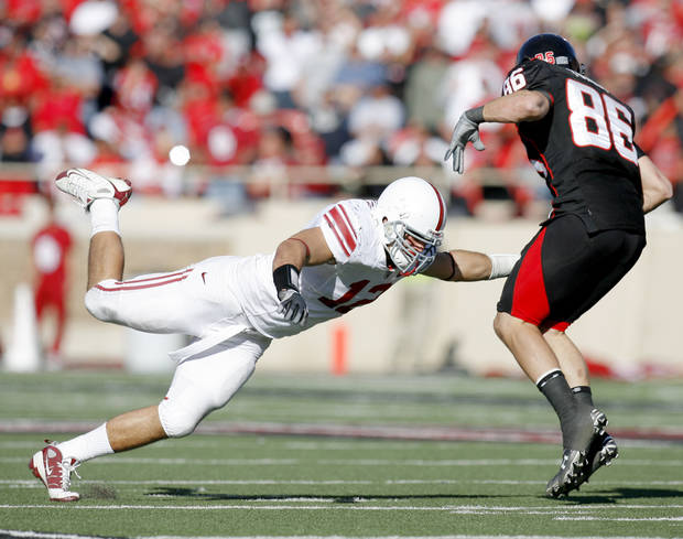 OU's Austin Box misses Texas Tech's Alexander Torres during the college football game between the University of Oklahoma Sooners (OU) and Texas Tech University Red Raiders (TTU ) at Jones AT&T Stadium in Lubbock, Texas., Saturday, Nov. 21, 2009. Photo by Bryan Terry, The Oklahoman
