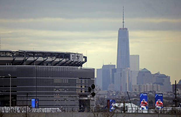 MetLife Stadium is seen in the foreground with the New York city skyline Monday, Jan. 27, 2014, before the NFL Super Bowl XLVIII football game in East Rutherford, N.J. (AP Photo/Charlie Riedel)