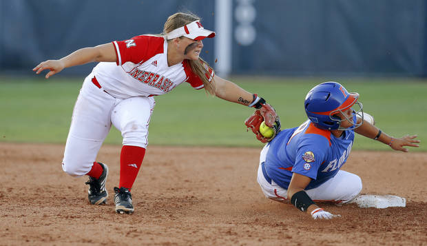 Florida's Stephanie Tofft steals second base past Nebraska's Hailey Decker in the sixth inning of their Women's College World Series softball game at ASA Hall of Fame Stadium in Oklahoma City, Saturday, June, 1, 2013. Photo by Bryan Terry, The Oklahoman