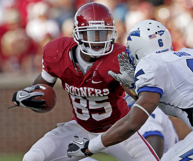 OU's Ryan Broyles tries to get past Jon Davis of Air Force during the second half of the college football gamebetween the University of Oklahoma Sooners (OU) and Air Force (AF) at the Gaylord Family-Oklahoma Memorial Stadium on Saturday, Sept. 18, 2010, in Norman, Okla.   Photo by Bryan Terry, The Oklahoman