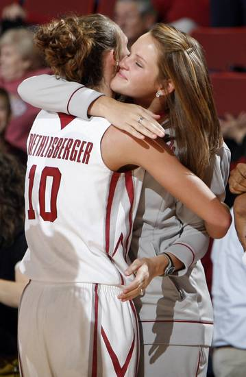 OU's Carlee Roethlisberger gets a hug from teammate Whitney Hand after their game vs. UT-Arlington in 2009. Hand was rehabbing a knee injury and did not play in the game. PHOTO BY NATE BILLINGS, The Oklahoman Archives