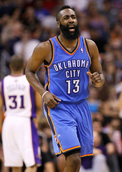 FILE - This April 18, 2012 file photo shows Oklahoma City Thunder guard James Harden reacting to a three-pointer against the Phoenix Suns during the second half of an NBA basketball game, in Phoenix. Harden's dominant fourth-quarter performance in a clinching Game 4 victory against Dallas was only the latest step in his recent rise to prominence. (AP Photo/Matt York, File)