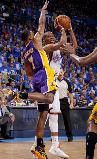 Oklahoma City's Russell Westbrook (0) goes to the basket beside Los Angeles' Ramon Sessions (7) during Game 1 in the second round of the NBA playoffs between the Oklahoma City Thunder and L.A. Lakers at Chesapeake Energy Arena in Oklahoma City, Monday, May 14, 2012. Photo by Bryan Terry, The Oklahoman