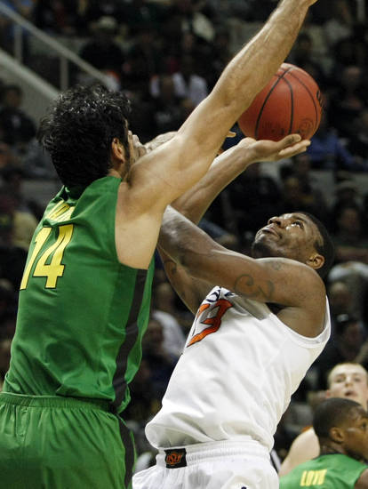 OSU's Marcus Smart has a shot blocked by Oregon's Arsalan Karzemi in the second round of the NCAA Basketball tournament in San Jose, CA, Mar. 21, 2013. STEPHEN PINGRY/Tulsa World