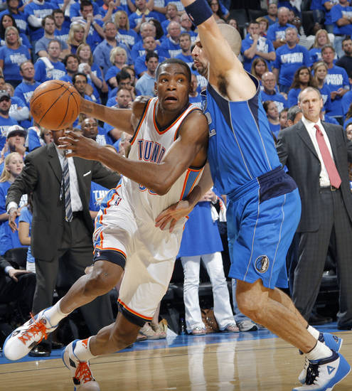 Oklahoma City's Kevin Durant (35) drives past Jason Kidd (2) of Dallas during game 3 of the Western Conference Finals of the NBA basketball playoffs between the Dallas Mavericks and the Oklahoma City Thunder at the OKC Arena in downtown Oklahoma City, Saturday, May 21, 2011. Photo by Chris Landsberger, The Oklahoman