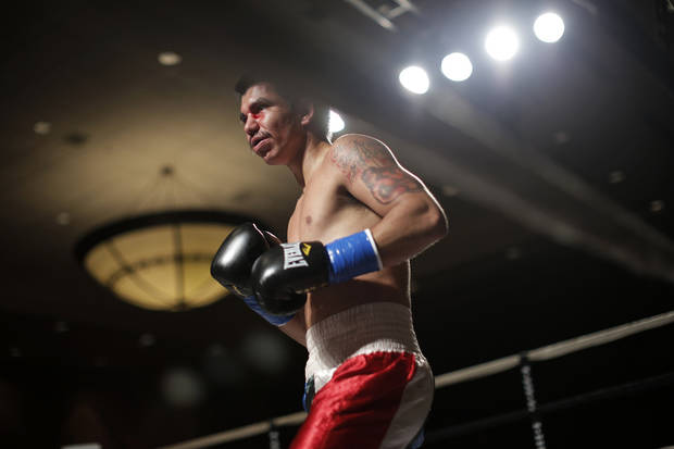 Octavio Garay, of Muleshoe, Texas, during a fight against Vincente Hernandez, of Oklahoma City, at the Cox Convention Center in Oklahoma City, Thursday, Sept. 20, 2012.  Photo by Garett Fisbeck, The Oklahoman