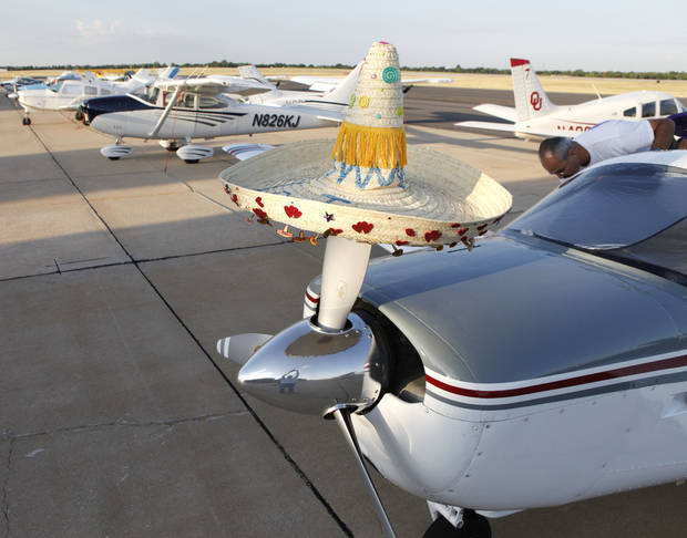 In this 2010 photo, a sombrero sitting on top of a propeller hints at the festive nature of the annual Okie Derby Proficiency Air Race. PHOTO BY PAUL HELLSTERN, THE OKLAHOMAN. <strong>PAUL HELLSTERN</strong>