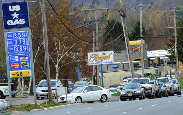 Customers line up along Route 22 East at the US Gas, Saturday, Nov. 3, 2012, in Pohatcong Township, N.J., as the gas rationing ordinance goes into effect. Weary of cleaning up from the superstorm that battered the state and with more than 1 million of them still without power, New Jerseyans were handed a new challenge Saturday: rationed gas in the northern half of the state, a system that caused confusion, frustration and desperation. Gov. Chris Christie ordered the rationing system for 12 counties, saying it would help ease fuel shortages and the long lines at gas stations and remain in place as long as Christie deemed a need for it. (AP Photo/The Express-Times, Stephen Flood)
