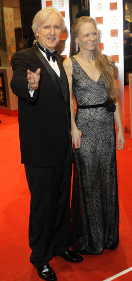 Canadian director James Cameron, left and his wife, Suzy Amis, arrive at the British Academy Film Awards 2010 at The Royal Opera House in London, Sunday, Feb. 21, 2010.  (AP Photo/Joel Ryan) ORG XMIT: LDJ135