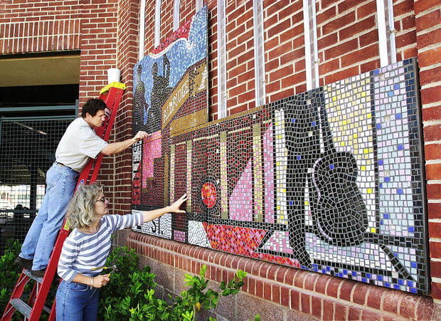 Artist Susan Morrison and her husband, Anthony Dyke, put finishing touches in 2000 on a mosaic at what is now known as Chickasaw Bricktown Ballpark. Photo by Paul B. Southerland, The Oklahoman