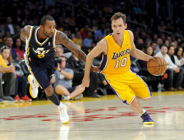 Utah Jazz guard Mo Williams (5) grabs Los Angeles Lakers guard Steve Nash (10) shirt as he gets by him during the first half of an NBA preseason basketball game, Saturday, Oct. 13, 2012, in Los Angeles. (AP Photo/Gus Ruelas)