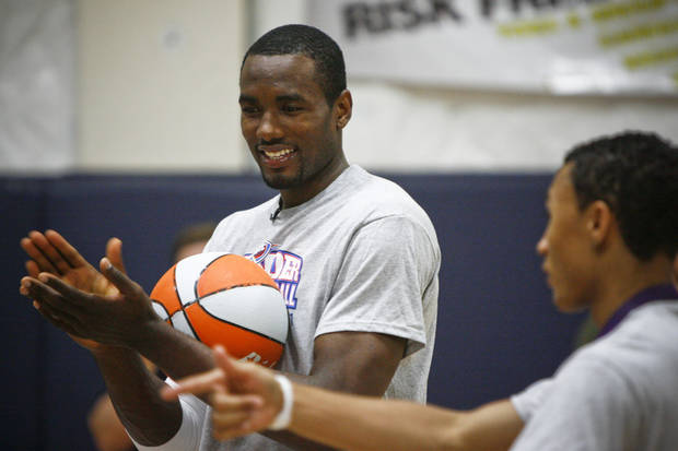 Serge Ibaka laughs during a drill at the Thunder Youth Basketball Camp at the Santa Fe Family Life Center on Tuesday, June 14, 2011. Photo by Zach Gray, The Oklahoman