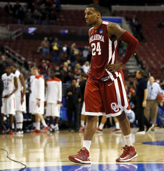 Oklahoma's Romero Osby (24) leaves the court after a game between the University of Oklahoma and San Diego State in the second round of the NCAA men's college basketball tournament at the Wells Fargo Center in Philadelphia, Friday, March 22, 2013. San Diego State beat OU, 70-55. Photo by Nate Billings, The Oklahoman
