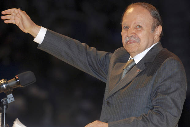   FILE - In this Monday, April 6, 2009 file photo, Algerian President Abdelaziz Bouteflika, gestures, during his last campaign rally in Algiers. The 72-year-old president Bouteflika is running against five other candidates, all low-profile figures. Algerians riveted are a new string of corruption allegations against top officials that show all the signs of being a behind-the-scenes struggle ahead of key presidential elections in 2014.(AP Photo, File)  