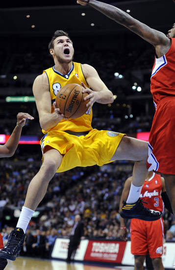 Denver Nuggets forward Danilo Gallinari (8), of Italy, shoots against Los Angeles Clippers center DeAndre Jordan (6) during the third quarter of an NBA basketball game, Tuesday, Jan. 1, 2013, in Denver. (AP Photo/Jack Dempsey)