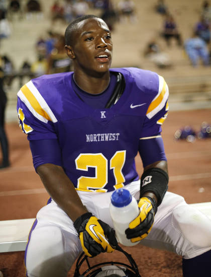 NWC's Lorenzo Alexander rests after one of his four touchdowns at the Northwest Classen vs. Western Heights high school football game at Taft Stadium Thursday, September 20, 2012. Photo by Doug Hoke, The Oklahoman