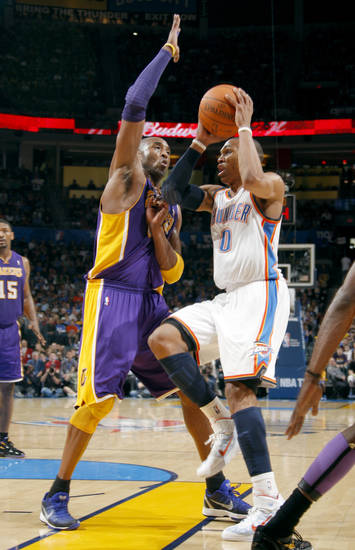 Oklahoma City's Russell Westbrook (0) shoots as Lakers' Kobe Bryant (24) defends during the NBA basketball game between the Oklahoma City Thunder and the Los Angeles Lakers, Sunday, Feb. 27, 2011, at the Oklahoma City Arena.Photo by Sarah Phipps, The Oklahoman