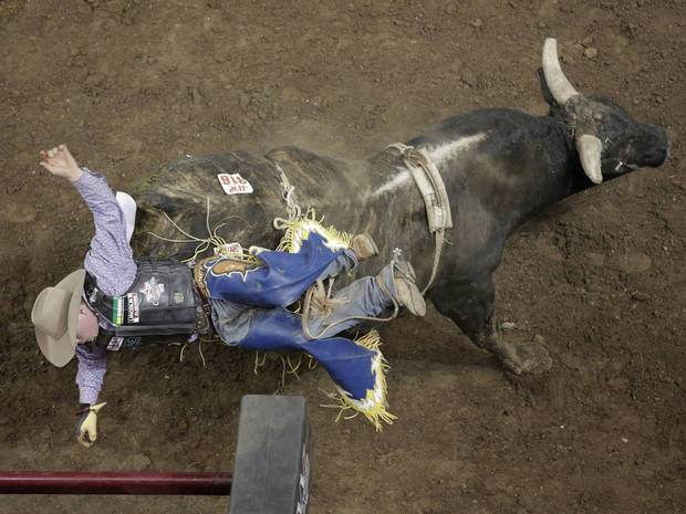 A bull rider is thrown from a bull during the final performance of International Finals Rodeo at the State Fair Arena in Oklahoma City, Okla., Sunday, Jan. 20, 2013.  Photo by Garett Fisbeck, For The Oklahoman