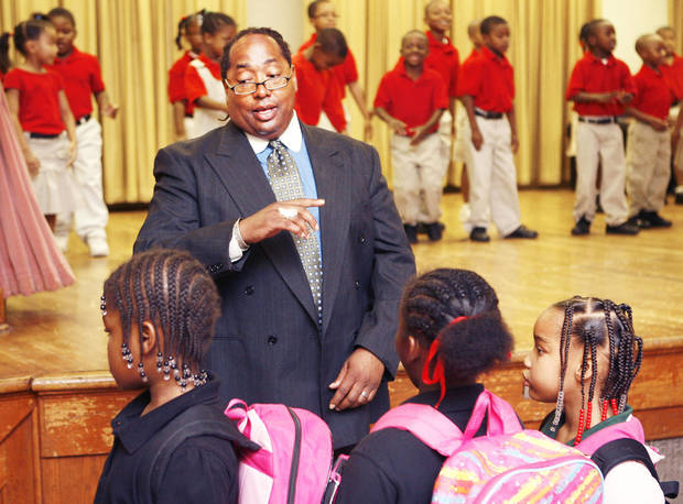 Kevin McPherson speaks to children during an assembly last month at the Marcus Garvey Leadership Charter School, which he started in northeast Oklahoma City. By Paul Hellstern