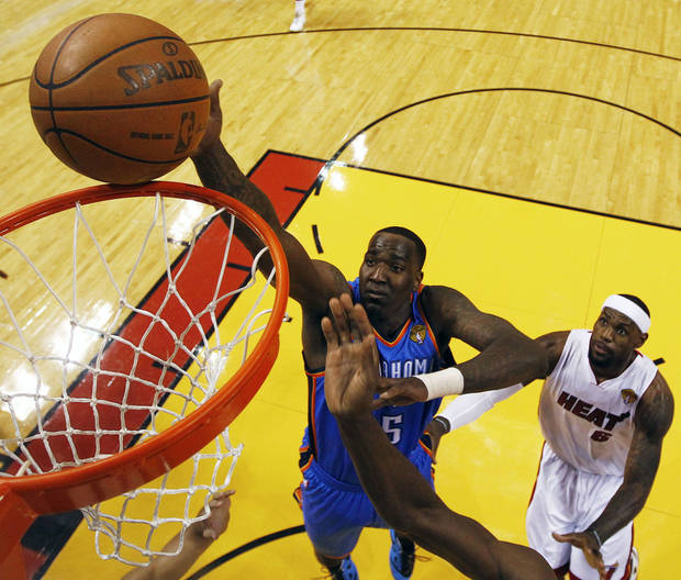 Oklahoma City Thunder center Kendrick Perkins (5) shoots as Miami Heat small forward LeBron James (6) defends during the first half at Game 3 of the NBA Finals basketball series, Sunday, June 17, 2012, in Miami. (AP Photo/Mike Ehrmann, Pool) ORG XMIT: NBA126
