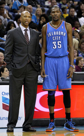 New Orleans Hornets head coach Monty Williams, left, talks to Oklahoma City Thunder small forward Kevin Durant (35) during the second half of an NBA basketball game in New Orleans, Friday, Nov. 16, 2012. The Thunder won 110-95. (AP Photo/Jonathan Bachman)