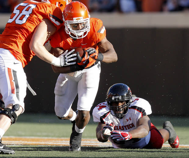 Oklahoma State's Joseph Randle (1) runs past Texas Tech's Dartwan Bush (54) during a college football game between Oklahoma State University (OSU) and Texas Tech University (TTU) at Boone Pickens Stadium in Stillwater, Okla., Saturday, Nov. 17, 2012.  Photo by Bryan Terry, The Oklahoman