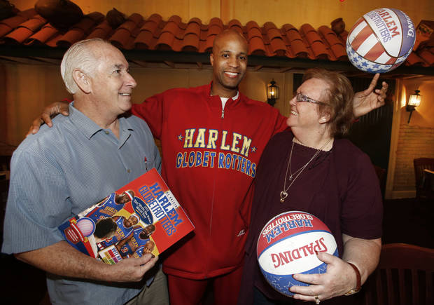 Harlem Globetrotter Flight Time Lang poses for a photo with George and Lin Wilson. Their first date as a married couple was to a Globetrotter game in 1963. Photos By Steve Gooch, The Oklahoman