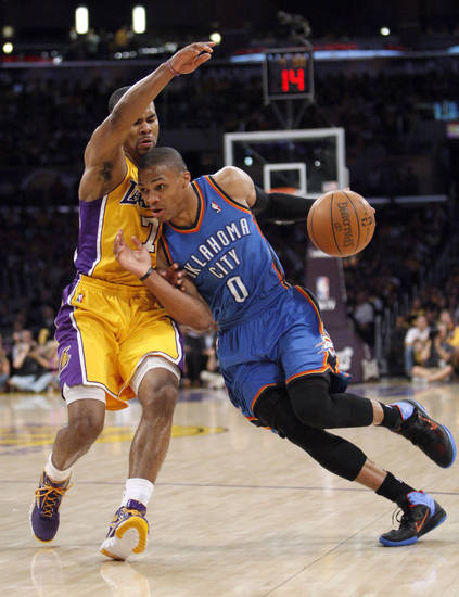 Oklahoma City's Russell Westbrook (0) drives past Los Angeles' Ramon Sessions (7) during Game 4 in the second round of the NBA basketball playoffs between the L.A. Lakers and the Oklahoma City Thunder at the Staples Center in Los Angeles, Saturday, May 19, 2012. Photo by Nate Billings, The Oklahoman