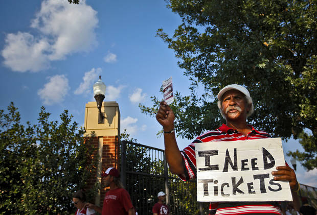 Harley 'Any Tickets' tries to buy and sale tickets outside the stadium before the start of the college football game between the University of Oklahoma Sooners (OU) and the Tulsa University Hurricanes (TU) at the Gaylord Family-Memorial Stadium on Saturday, Sept. 3, 2011, in Norman, Okla. 