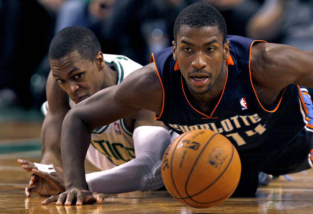 Charlotte Bobcats forward Michael Kidd-Gilchrist, right, and Boston Celtics guard Rajon Rondo, left, chase a loose ball during the second half of an NBA basketball game in Boston, Monday, Jan. 14, 2013. (AP Photo/Charles Krupa)