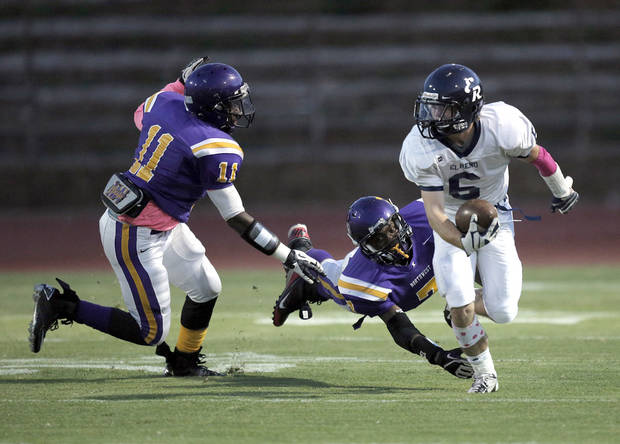 El Reno's Bailey Denny (6) runs from NWC's Damon Cozine (7) and Isaiah Beverly (11) during a high school football game between Northwest Classen and El Reno at Taft Stadium in Oklahoma City, Friday, Oct. 5, 2012.  Photo by Garett Fisbeck, The Oklahoman